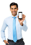 Portrait Of Businessman Showing Smart Phone Royalty Free Stock Photography