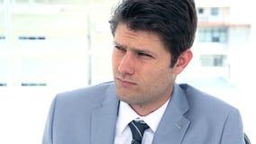 Portrait of a businessman sighing