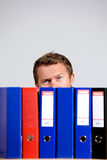 Portrait of businessman sitting behind files at office royalty free stock images