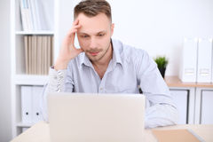 Portrait of businessman sitting at the desk in office workplace Royalty Free Stock Photo