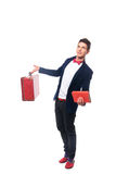 Portrait of Businessman sitting on his suitcase while and smile Royalty Free Stock Photo