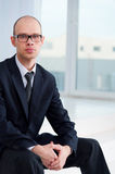 Portrait of businessman sitting in office Royalty Free Stock Photo