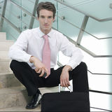 Portrait of a businessman sitting on steps Royalty Free Stock Image