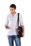Portrait of a businessman with smartphone. Stock Image