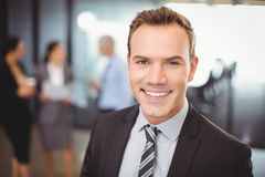 Portrait businessman smiling at camera Royalty Free Stock Image