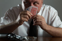 Portrait of businessman smoking and play poker Royalty Free Stock Photo