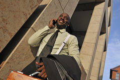 Portrait of Businessman Speaking on Mobile Phone Stock Photo