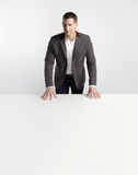 Portrait of a businessman standing behind table Royalty Free Stock Image