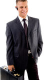 Portrait of businessman standing with briefcase Royalty Free Stock Photography
