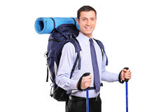 Portrait of a businessman in a suit with backpack Royalty Free Stock Photography