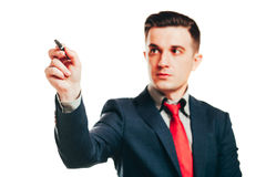 Portrait of businessman in suit holding a pen Royalty Free Stock Photos