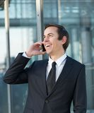 Portrait of a businessman talking and laughing on mobile phone. Close up portrait of a businessman talking and laughing on mobile phone Stock Photos