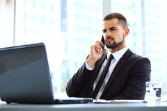 Portrait of businessman talking on mobile phone Stock Photography
