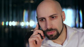 Portrait of a businessman talking on the phone stock video