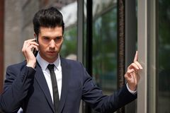Portrait of a businessman talking on phone outdoors Royalty Free Stock Photography