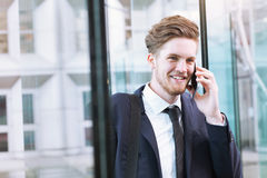 Portrait of businessman talking by phone Stock Images