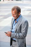 Portrait of businessman text messaging Stock Photo