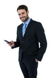 Portrait of businessman text messaging on mobile phone Stock Image