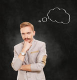 Portrait of a businessman with thinking cloud Stock Photo