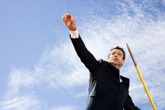Portrait of a businessman throwing a javelin Royalty Free Stock Photos