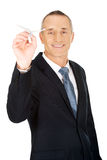 Portrait of businessman throwing a paper plane Royalty Free Stock Photography