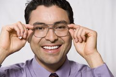 Portrait Of A Businessman Trying Out Glasses Stock Photos