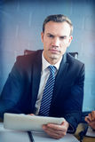 Portrait of businessman using digital tablet Royalty Free Stock Image