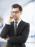 Portrait of a businessman using his mobile Stock Photo