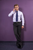 Portrait of businessman using mobile phone at office Royalty Free Stock Images