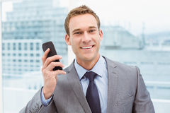 Portrait of businessman using mobile phone Stock Photography