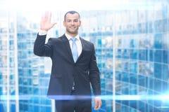 Portrait of businessman waving hand Stock Photography