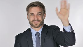 Portrait of businessman waving hand to welcome stock video footage