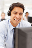 Portrait of businessman wearing headset Stock Image