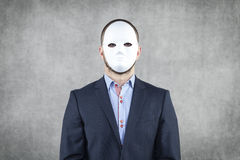 Portrait of a businessman wearing a mask. Portrait of a business man wearing a mask Stock Photo