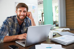 Portrait Of Businessman Working In Creative Office Stock Images