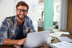 Portrait Of Businessman Working In Creative Office Royalty Free Stock Images