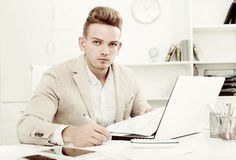 Portrait of  businessman working in modern office Royalty Free Stock Photos