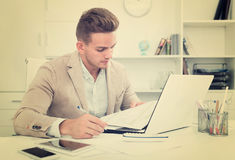 Portrait of businessman working in modern office stock image