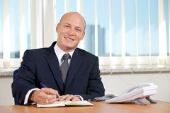 Portrait of businessman working at office Stock Photos