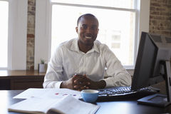 Portrait Of Businessman Working In Office Stock Photos
