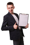 Portrait of businessman writing on clipboard isolated on white b Royalty Free Stock Photography