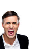 Portrait of a businessman yelling. Over white background Royalty Free Stock Photography