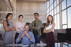 Portrait of businessman with young team at office Stock Images