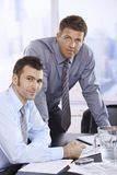 Portrait of businessmen at desk Royalty Free Stock Image