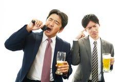 Portrait of businessmen drinking beer stock image
