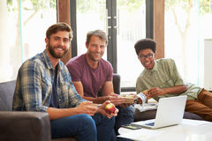 Portrait Of Businessmen Having Working Lunch In Office Royalty Free Stock Image
