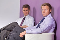 Portrait of businessmen sitting at office Royalty Free Stock Photo