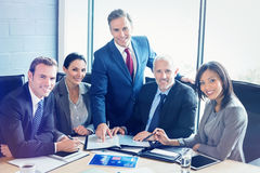 Portrait of businesspeople in conference room. Portrait of businesspeople interacting in conference room during meeting at office royalty free stock photo