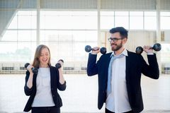 Businesspeople in a gym. A portrait of businesspeople doing sports in a gym stock photos