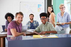 Portrait Of Businesspeople Having Creative Meeting In Office Stock Photos